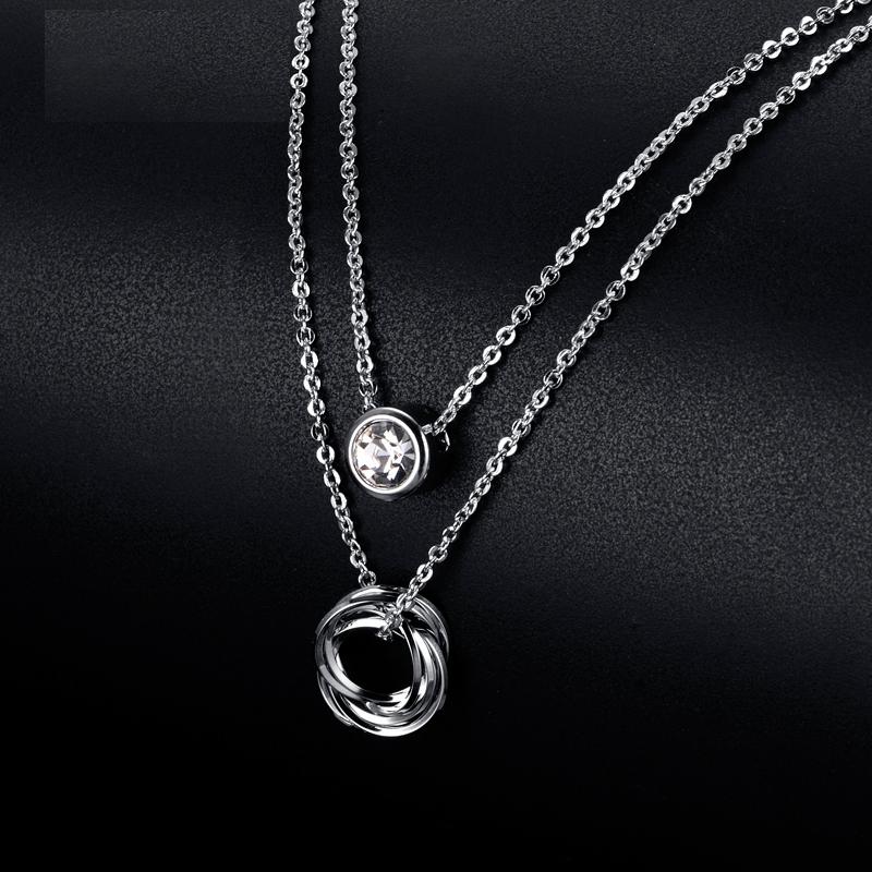 Dvojitá retiazka z bieleho zlata a príveskami - FashionGate.sk ba49f89e45f